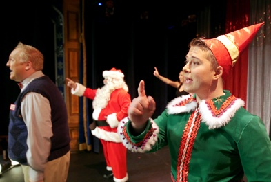 UA custodian Teddy Cleveland dressed as an elf during a performance at The Gaslight Theatre.