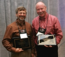 The UA's Steve Holland (right) was honored as a 2008 Distinguished Risk Manager, along with Mike Bale of Oklahoma State University.