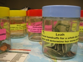 """Employees in Student Financial Aid are giving via """"I Dare You"""" Jars."""