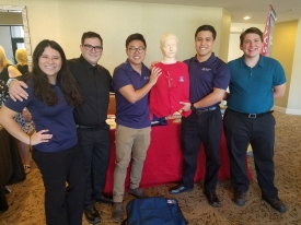 """A group of volunteers taught chest-compression-only CPR at the College of Medicine – Tucson's """"Doc Talks"""" lecture series. From left: Yee, Adam Gross, Maxwell Li, Ryan Yee and Tim Gustafson."""