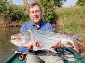 Herman in Tanzania with the tigerfish he caught in a river full of crocodiles and hippopotamuses.
