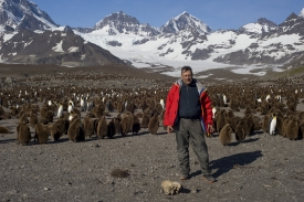Herman in South Georgia, surrounded by penguins.