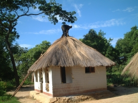 A typical mud-brick, thatched-roof hut in Zambia, like the one Alyssa Guido stayed in as a Peace Corps volunteer.
