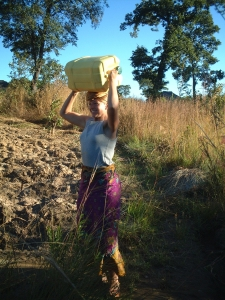 There was no running water in the Zambian village where Alyssa Guido stayed, so she learned to tote water like the locals.
