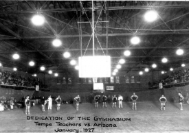 A flash reflects off the backboard in this photo of the 1927 dedication of the building.