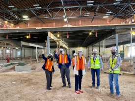 Provost Liesl Folks (center) tours Bear Down Gymnasium to see how renovations are progressing.