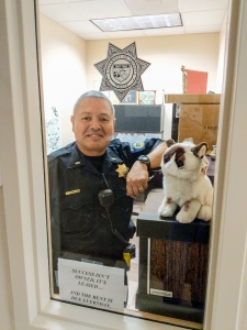 Caballero poses in his office with a stuffed Grumpy Cat.