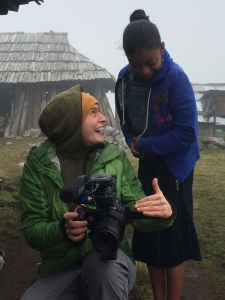 Mari Cleven, senior videographer in the Office of Research, Discovery and Innovation, shows her footage to a resident of Todos Santos Cuchumatan in Guatemala. Cleven's video – from the trip she took with UA scientists – earned her an Emmy. (Photo by Kevin Anchukaitis)