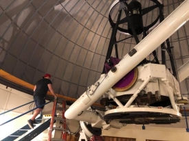 Theodore Pruyne climbs up to the catwalk of the 96-inch telescope to prepare for an observation run.