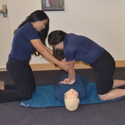 Yee, right, doing compressions on a mannequin.