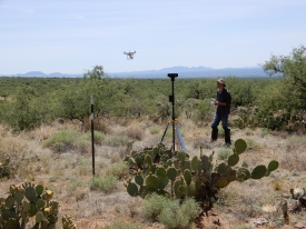 Jeffrey Gillan, senior research specialist in the School of Natural Resources and the Environment, uses drones to help assess and maintain the health of grazing lands. (Photo by Alessandra Gorlier/School of Natural Resources and the Environment)
