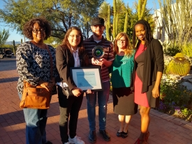 University Libraries staff with their Diversity and Inclusion Award from the Society for Human Resource Management of Greater Tucson. (From left) Cheryl Neal, senior library information associate, Rachel Martinez, senior library information associate, Ryan Tombleson, information technology support analyst, Glenda Hendrickson, senior program coordinator, and Kenya Johnson, manager of marketing and communications. (Photo: Shawna Thompson/University Libraries)