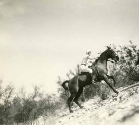 Riders in the University's Women's Riding Class practice uphill horseback maneuvers. The photograph is a gift of R.B. Streets, 1973. (Courtesy of Special Collections)