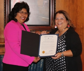 Teshia Solomon, right, with Rep. Sally Ann Gonzales.