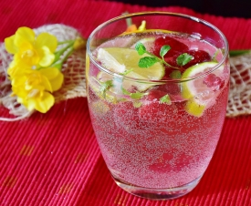 Sparkling water with fresh fruit is a healthier but still flavorful alternative to soda at parties.