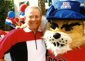 Sypherd with Wilbur T. Wildcat at a University of Arizona basketball game in Sacramento, California, in 1998
