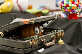 This pumpkin, crafted to appear as if it were eerily crawling out of a suitcase, earned second place in the Office of the Provost's pumpkin-crafting contest last year. The contest will be held again this year on Oct. 30. (Photo: Kyle Mittan/University Communications)