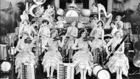 "Photograph of The Ingenues, an all female Vaudeville-style jazz band, from the 1928 motion picture ""The Band Beautiful."" (Courtesy of Special Collections)"