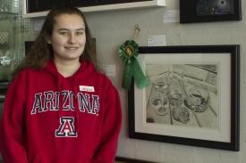 "Winona Esher, the daughter of Melanie Esher-Blair, senior program coordinator for the Arizona Telemedicine Program, has won the exhibit's art education award twice. Last year, she won for a drawing titled ""Water Glass."""
