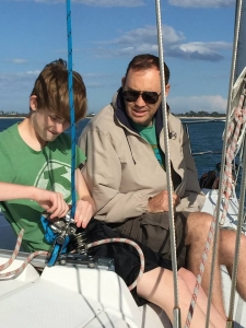 Burgess and his son, Aidan, sailing during a family vacation in Australia.
