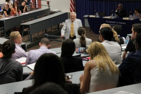 Charles E. Ares addresses new law students during orientation in 2014.