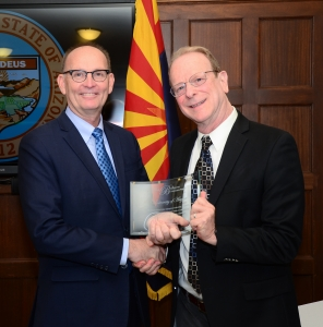 Greg Ibach, left, undersecretary for marketing and regulatory programs in the U.S. Department of Agriculture, presents the Pink Bollworm Cooperative Program Award to Bruce Tabashnik, head of the Department of Entomology. The award recognizes the UA for its role in eliminating the invasive pink bollworm from all cotton-producing areas in the continental U.S.