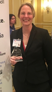 Michelle Dorsey, clinical assistant professor of radiology at the College of Medicine – Phoenix, with her Service to the Citizen Award.