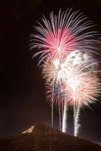"""Interested in braving the heat to catch the July 4 fireworks show over """"A"""" Mountain? Three UA parking garages will offer prime viewing. (Photo courtesy of the UA Alumni Association)"""