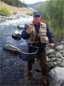 Kern, who enjoys fly fishing in his spare time, shows off a great catch.