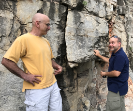 Alon Efrat (left) and Joshua Levine, faculty members in the Department of Computer Science, examine a piece of rock on Mount Lemmon. Both work with John Kemeny, a professor in the Department of Mining and Geological Engineering, who was among the first to receive an International Research and Academic Program Development grant. (Photo credit: John Kemeny)