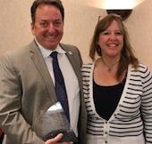 Arizona Public Media Executive Producer John Booth with Kathy DiNolfi, president of the Arizona Community Action Association