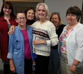 At the surprise belling, Judi Carrington holds the Ben's Bell surrounded by, from left, Catalina Sherwood (Carrington's daughter), Lois Bowen, friend Kathleen Escalada, Sarah Ascher and AHSC BioCommunications' Darla Keneston.