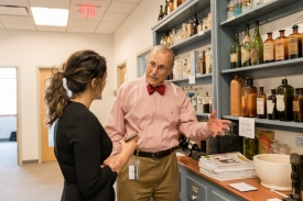 Kravetz discusses his collection with Lindsay Roberts, an associate media specialist at the College of Medicine – Phoenix. Kravetz says understanding the history of medicine can provide lessons for future physicians. (Photo by Tabbs Mosier/College of Medicine – Phoenix)