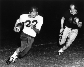 Art Luppino, left, during a football game in 1954. The photo served as inspiration for the mural. (Courtesy of the Arizona Daily Star)