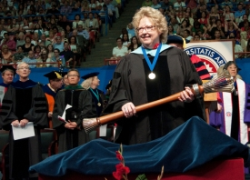 Professor Emerita Wanda Howell holds the UA's ceremonial mace at the 2012 commencement ceremony. The mace, which represents the UA president's legal and chartered authority, will appear at the installation of President Robert C. Robbins. (Photo: Patrick McArdle)