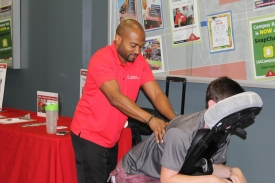 On the first Tuesday of every month, massage therapists offer free chair massages in the lobby of the Student Recreation Center. (Photo courtesy of Campus Recreation)