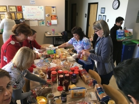Employees at Campus Health making sandwiches for Casa Maria, a charity that feeds the poor.