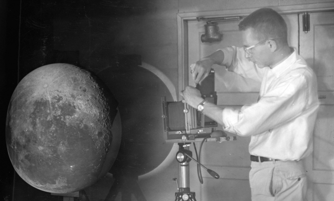 "Lunar and Planetary Laboratory doctoral graduate William Hartmann projects photographic plates of the moon onto a white hemisphere to create the Rectified Lunar Atlas. Hartmann's work with other UA scientists, and the story behind the UA's mapping of the moon, is the focus of ""Moon,"" a Special Collections exhibit. (Photo courtesy of the UA Lunar and Planetary Laboratory)"