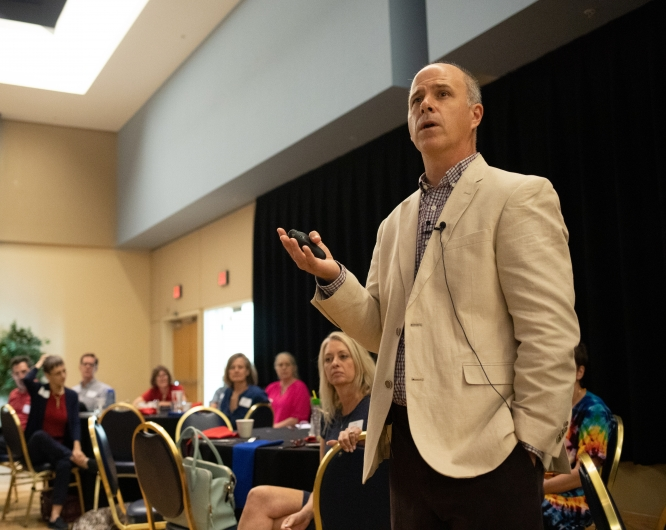 James Lang, a scholar on teaching and learning, during his talk in the Student Union Memorial Center's South Ballroom on Friday. The talk, presented by the Center for University Education Scholarship, covered ways faculty can cultivate their students' attention. (Photo by Veronica Rodriguez/Office of Instruction and Assessment)