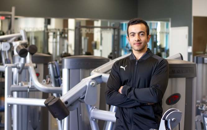Ahmad Alrashedi, a personal trainer at Campus Recreation, will lead the Sunrise Fit program when it begins on Feb. 5. The class aims to teach exercises that address the physical effects of aging. (Photo: Kyle Mittan/University Communications)
