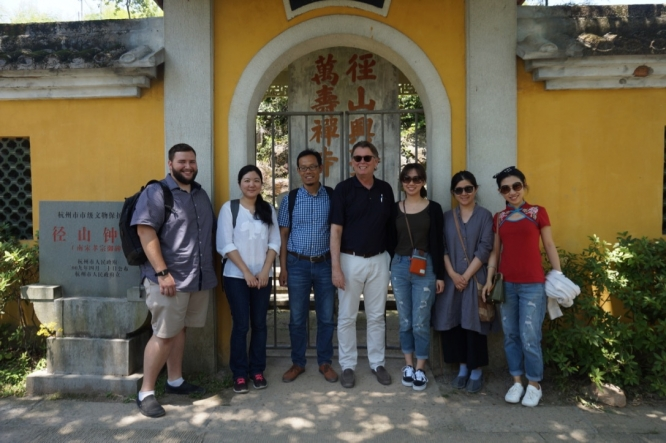 UA professor Albert Welter (center) with colleagues and graduate students outside a gate at Jingshan Monastery, one of China's most famous temples. (Photo credit: Albert Welter)