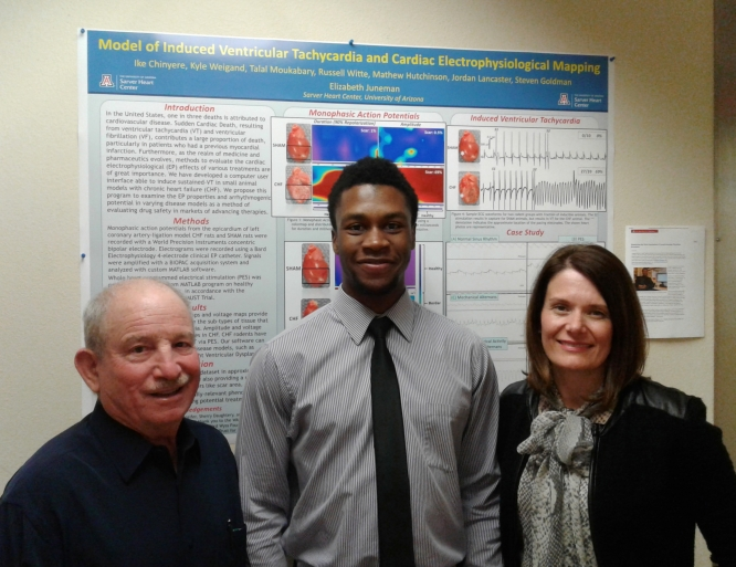 "UA Honors College student and graduating senior Ikeotunye ""Ike"" Royal Chinyere (center) is being jointly mentored by Steven Goldman and Elizabeth Juneman at the Sarver Heart Center. (Photo credit: Grace Gorman/UA Sarver Heart Center)"