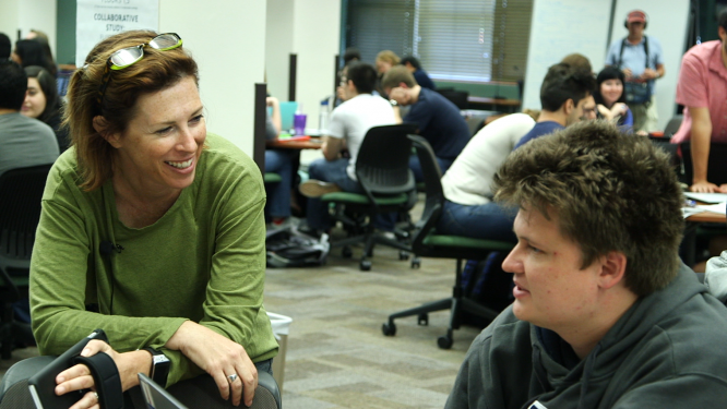 Zoe Cohen, an assistant professor in the Department of Physiology, talks with a student in a collaborative learning space on the UA campus. Cohen found that a simple email reaching out to struggling students helped boost their success.