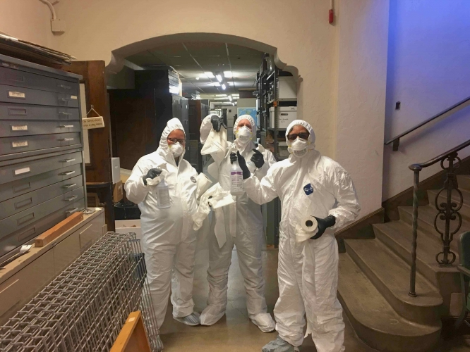(From left) Custodians Lilliana González and Kyle Graves and custodial project manager Jose Solis take a break while disinfecting the Arizona State Museum.