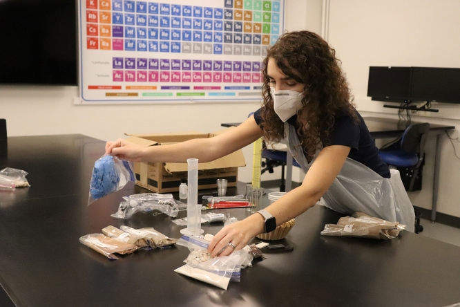Rivka Fidel, assistant professor of practice in the Department of Environmental Science, packs kits she designed for students in her online Introduction to Soil Science course.