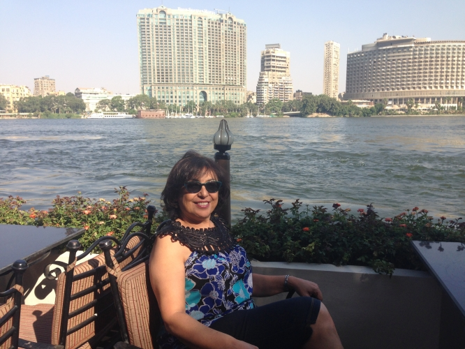 Iman Hakim on a recent trip to Egypt, sitting on the bank of the Nile.
