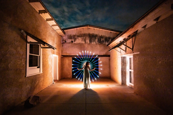 """Yuanyuan """"Kay"""" He explores light painting, which combines photography with light and dance. He appears at the center of this image."""