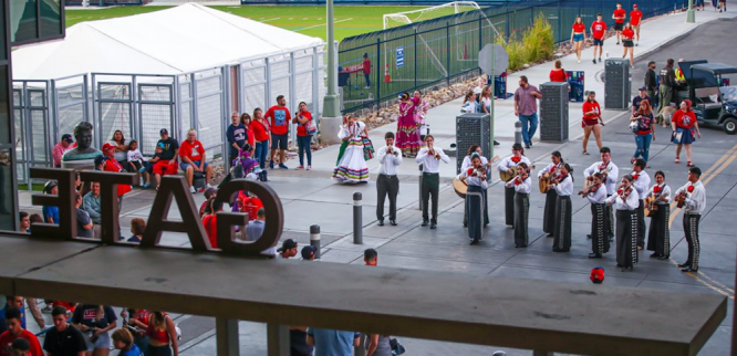Traditional folklórico dancers and mariachi bands welcomed fans as they entered the gates of Arizona Stadium at the 2019 Hispanic Heritage football game.