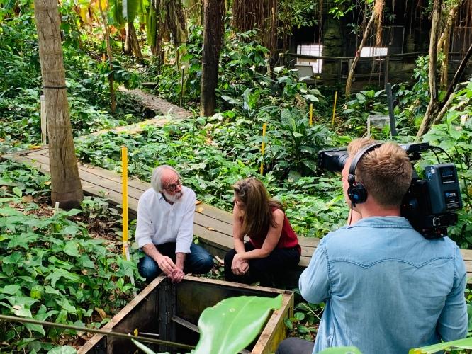 "Joaquin Ruiz talks with BBC's ""Follow the Food"" host JJ Ramberg in Biosphere 2's rainforest. (Courtesy of Biosphere 2)"