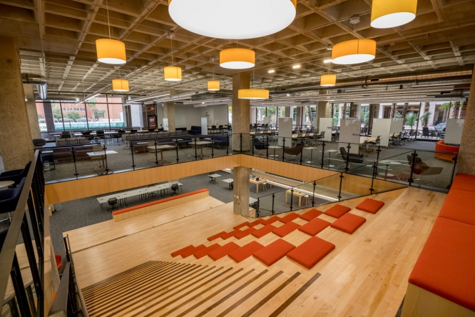 A seating area cascades alongside an open staircase in the renovated Main Library. (Photo by Chris Richards/University Communications)